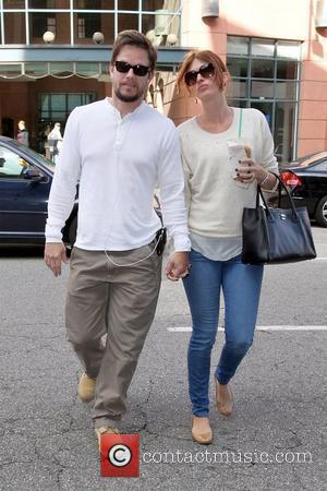 Mark Wahlberg and Rhea Durham Mark Wahlberg holding hands with his wife, as they arrive at a medical centre in...
