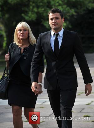 Mark Wright appears at Redbridge Magistrates Court with his mother Carol, charged with threatening and abusive behaviour London, England -...