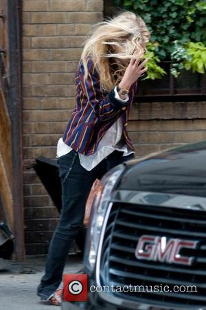 Mary-Kate Olsen hides her face from paparazzi whilst out and about in Manhattan New York City, USA - 03.06.11
