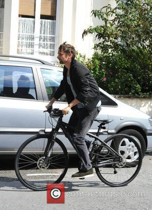 Muse frontman and new father Matt Bellamy riding his bike in North London London, England - 19.08.11