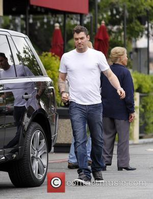 Brian Austin Green returns to his car after grabbing a coffee with wife Megan Fox Los Angeles, California - 11.11.11