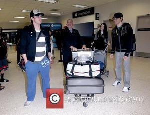Bradley James, Katie McGrath and Colin Morgan The stars of international smash hit BBC television show Merlin arrive at LAX...