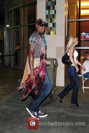 Dennis Rodman The Miami Dolphins vs The New England Patriots NFL Monday Night Football game at Sun Life Stadium -...
