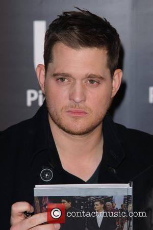 Michael Buble signs copies of illustrated autobiography 'Onstage, Offstage' at Waterstone's, Piccadilly. London, England - 14.10.11