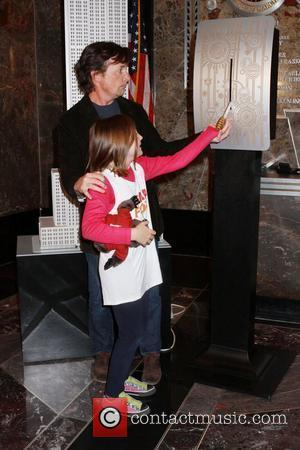 Michael J. Fox and his daughter Esme Fox  light the Empire State Building orange and white to raise awareness...