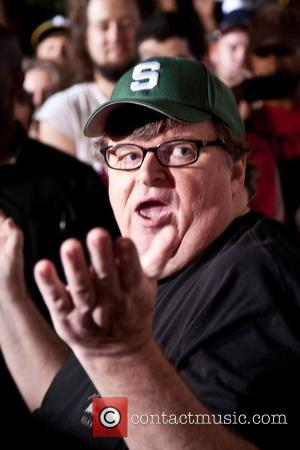 Michael Moore gives a live broadcast on network television from Zuccotti Park, while surrounded by protesters. New York City, USA...