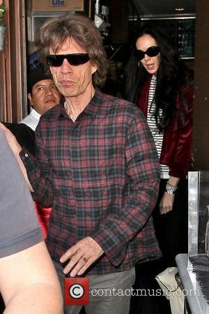 Mick Jagger and partner designer L'Wren Scott leaving Il Pastaio restaurant in Beverly Hills. Los Angeles, California - 05.03.11