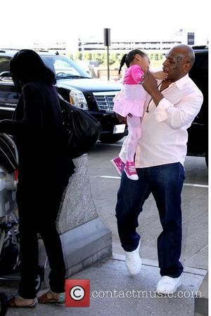 Mike Tyson and family at Dulles International Airport Washington DC, USA – 09.05.11