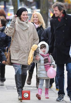 Milla Jovovich attends a festive Santa parade with her husband Paul W. S. Anderson and their daughter Ever Gabo Toronto,...