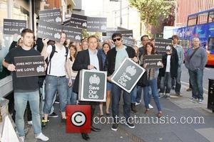 Rapper Example, real name Elliot Gleave, and Ministry of Sound CEO Lohan Presencer deliver a petition signed by 25,000 people...