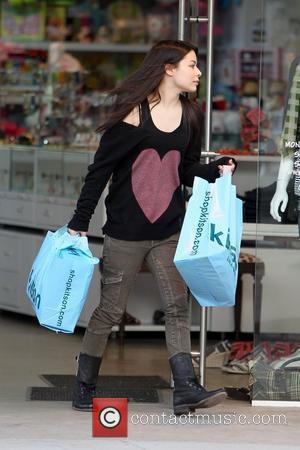 Miranda Cosgrove departs Kitson on Melrose Avenue with two large shopping bags Los Angeles, California - 25.03.11