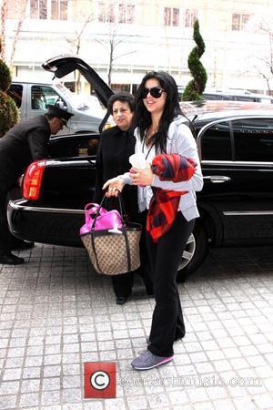 Miss USA Rima Fakih  checking into her hotel Washington DC, USA – 23.03.11