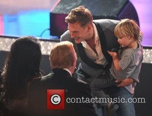 Lee Ryan of Blue introduces his son Ryan or Bruce Forsythe Miss World 2011 finals held at Earls Court. London,...