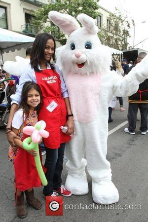 Zoe Saldana with her Niece Kayla Los Angeles Mission Easter for the Homeless held at the Los Angeles Mission Los...