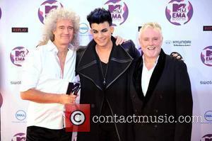 Brian May, Adam Lambert and Roger Taylor  The MTV Europe Music Awards 2011 (EMAs) held at the Odyssey Arena...