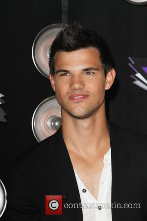 Taylor Lautner Too Busy To Enjoy Success