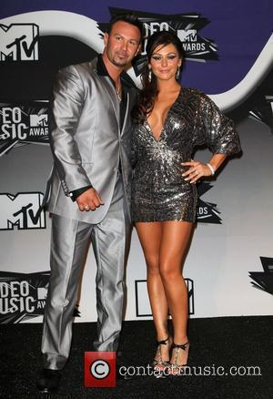 Jenni Farley aka 'JWoWW' and Roger Mathews 2011 MTV Video Music Awards held at LA Live - Press Room Los...