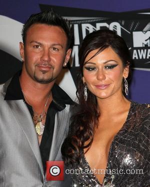 Jenni Farley aka 'JWoWW' and Roger Mathews 2011 MTV Video Music Awards held at LA Live - Press Room Los...