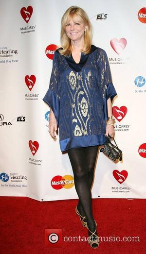 Cheryl Tiegs  2011 MusiCares Person of the Year Tribute to Barbara Streisand held at the Los Angeles Convention Center...