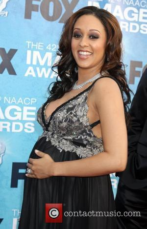 Tia Mowry  42nd NAACP Image Awards at The Shrine Auditorium - Arrivals Los Angeles, California, USA - 04.03.11
