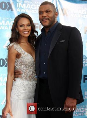 Tyler Perry and Guest 42nd NAACP Image Awards at The Shrine Auditorium - Arrivals Los Angeles, California, USA - 04.03.11