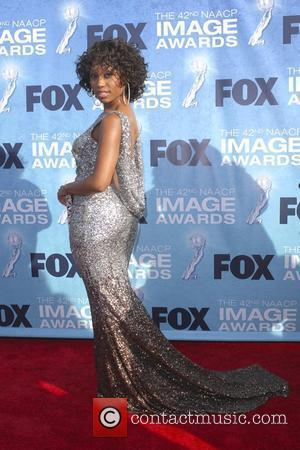 Angell Conwell 42nd NAACP Image Awards at The Shrine Auditorium - Arrivals  Los Angeles, California, USA - 04.03.11