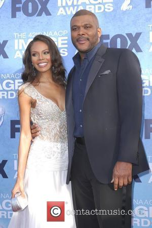 Tyler Perry and wife 42nd NAACP Image Awards at The Shrine Auditorium - Arrivals  Los Angeles, California, USA -...