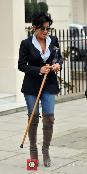 Nancy Dell'Olio leaves home carrying a walking stick after hurting her leg during rehearsals for 'Strictly Come Dancing' London, England...