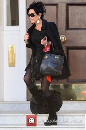 Nancy Dell'Olio leaving home to head to 'Strictly Come Dancing' rehearsals  London, England - 14.10.11