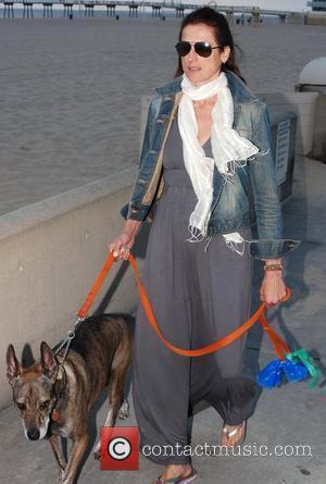 Actress Nancy La Scala  walking her dog on The Strand on Hermosa Beach Los Angeles, California, USA - 06.05.11