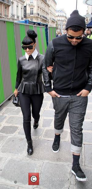 Natalia Kills English singer-songwriter walking in Paris wearing large black sunglasses Paris, France - 21.09.11
