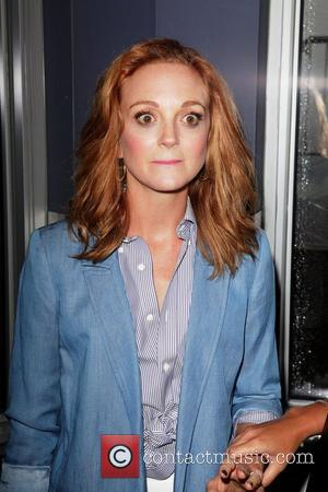 Jayma Mays attends the switching on of the lights at the Empire State Building in honour of New York Smurf...