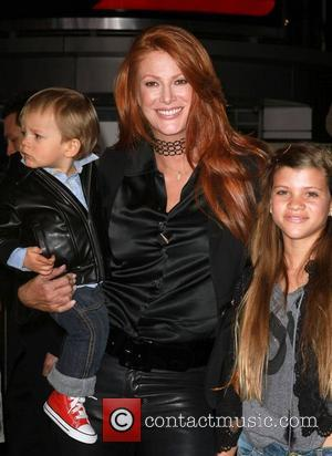 Angie Everhart and Justin Bieber