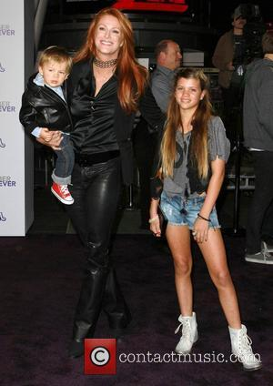 Angie Everhart and Son Kayden Los Angeles Premiere of Justin Bieber: Never Say Never held at Nokia Theatre L.A. Live...