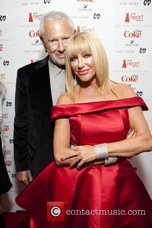Suzanne Somers wearing Ina Soltani with husband Alan Hamel  Mercedes-Benz IMG New York Fashion Week Fall 2011 - The...