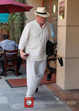Nick Nolte, dressed in all white attire, visits a medical building in Beverly Hills Los Angeles, California - 29.07.11