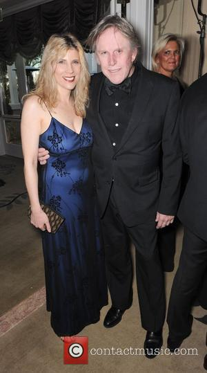 Gary Busey and Guest  The Norby Walters 21st Night of 100 Stars Awards Gala held at Beverly Hills Hotel...