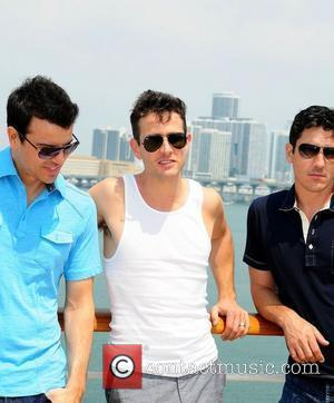 Jordan Knight, Joey McIntyre and Jonathan Knight Members of NKOTB attend the Third NKOTB Cruise at Port of Miami on...