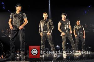 Brian Littrell, Nick Carter, AJ McLean and Howie Dorough of Backstreet Boys   performing live in concert on the...
