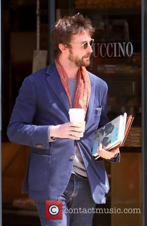 Noah Wyle carrying books and his iPad after buying a coffee in Beverly Hills. Wyle is seen carrying the novel...