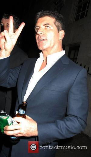 Simon Cowell,  at the News Of The World, Childrens Champions Awards, held at the Grosvenor House - Arrivals. London,...