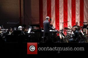 Mayor Michael Bloomberg conducts the Encores! Orchestra.  New York City Center Reopening Gala.  New York City, USA -...