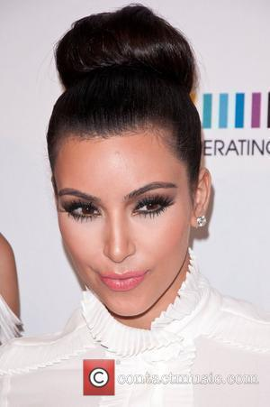 Kim Kardashian Saves The Day For Forgetful Phone Fan