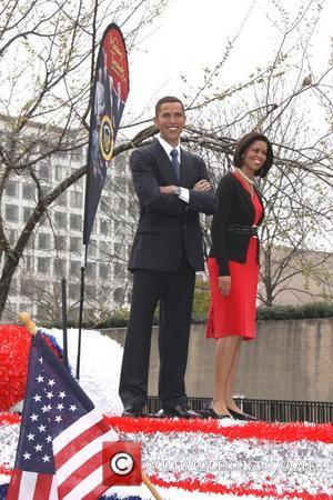 Madame Tussauds wax figures of President Obama and First Lady at the 2011 Cherry Blossom Parade  Washington D.C., USA...