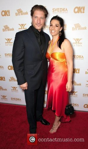 Sean Kanan and Guest  OK! Magazine And BritWeek Celebrate The Oscars at The London Hotel  West Hollywood, California...