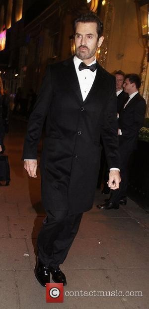 Rupert Everett ,  at the 2011 Olivier Awards - After Party at the Waldorf Hotel - Arrivals. London, England-...