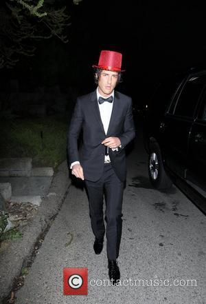 Brandon Davis wearing a red top hat arrives at a private residence in Hollywood for Paris Hilton's 30th birthday party...