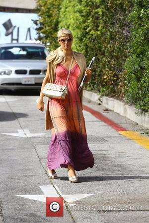 Paris Hilton in a Boho maxi dress and headband, leaves a nail salon in Beverly Hills carrying her Apple laptop...