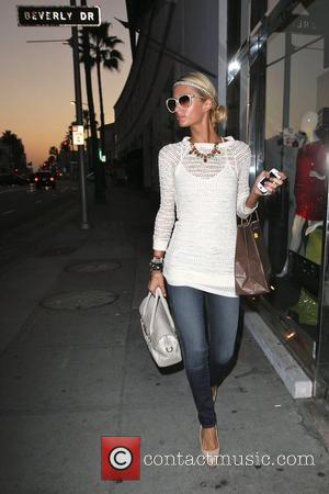 A heavily tanned Paris Hilton leaves Portofino Sun Center and Spa in Beverly Hills She has recently returned from Bali...