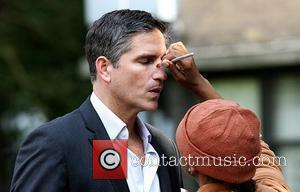 James Caviezel filming on the set of the new TV show 'Person of Interest' at Ebbets Field in Brooklyn New...